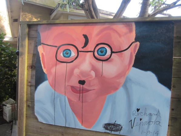 vandalized art on fence -forest knolls san francisco