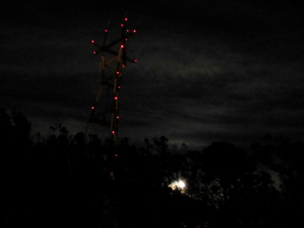 sutro tower with rising moon
